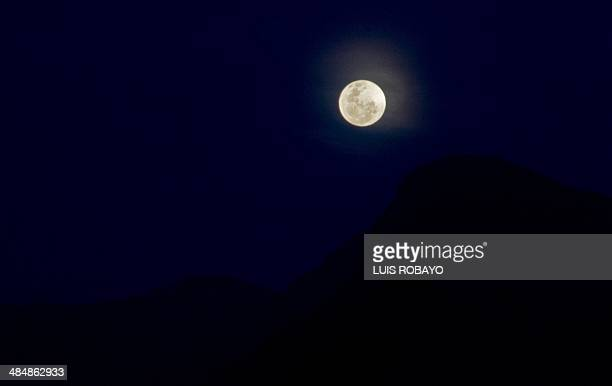 The moon is seen over Salento department of Quindio Colombia on April 14 2014 On Tuesday April 15th a total lunar eclipse will occur the first in a...