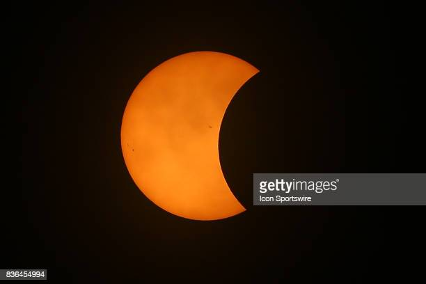 The Moon is seen passing in front of the Sun during a Solar Eclipse on August 21 2017 at Roxbury High School in Roxbury NJ A total solar eclipse...