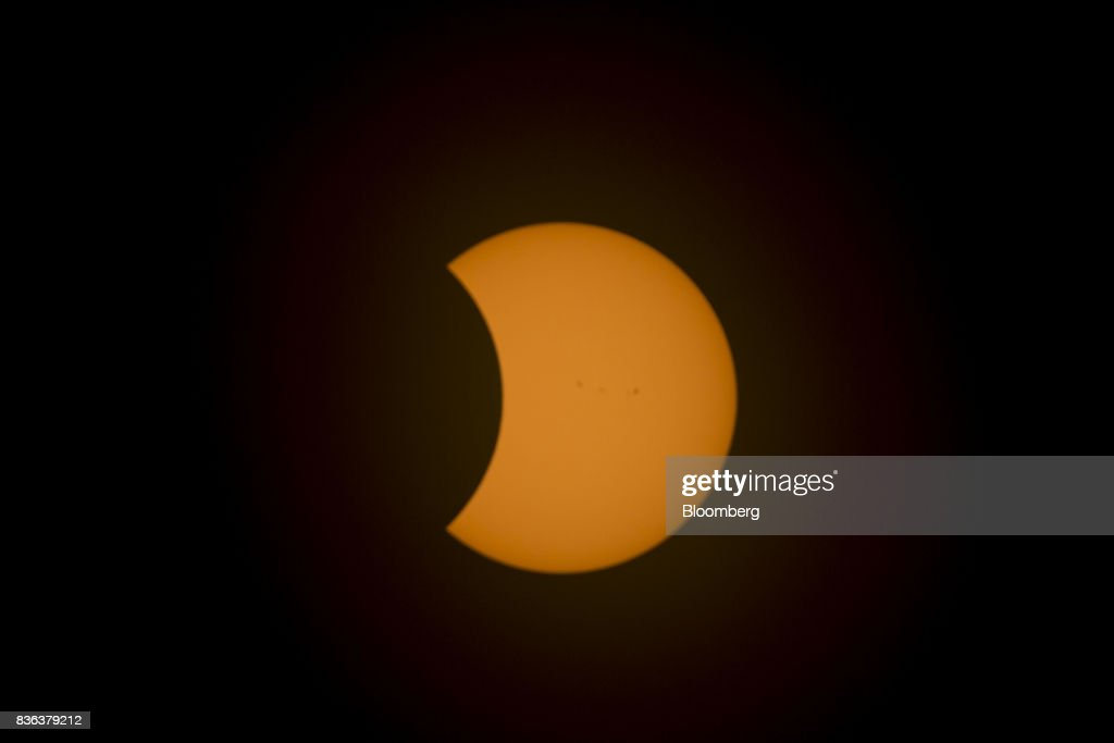 The moon moves in front of the sun after totality during a solar eclipse viewed from the campus of Southern Illinois University (SIU) in Carbondale, Illinois, U.S., on Monday, Aug. 21, 2017. Millions of Americans across a 70-mile-wide (113-kilometer) corridor from Oregon to South Carolina will see the sky darken as the sun disappears from view total during the eclipse, with Carbondale seeing totality for 2 minutes and 38 seconds. Photographer: Daniel Acker/Bloomberg via Getty Images
