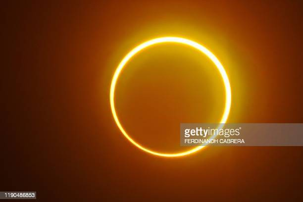 TOPSHOT The moon moves in front of the sun in a rare ring of fire solar eclipse as seen from Balut Island Saraggani province in the southern island...