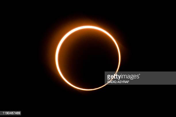 The moon moves in front of the sun in a rare ring of fire solar eclipse as seen from Tanjung Piai Malaysia on December 26 2019