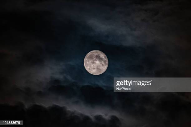 The moon on the sky at a cloudy and rainy night In Nea Artaki on June 7 2020