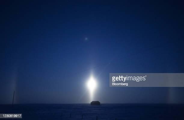 The moon over a cabin in a field along the Keystone XL pipeline route near Oyen, Alberta, Canada, on Wednesday, Jan. 27, 2021. U.S. President Joe...