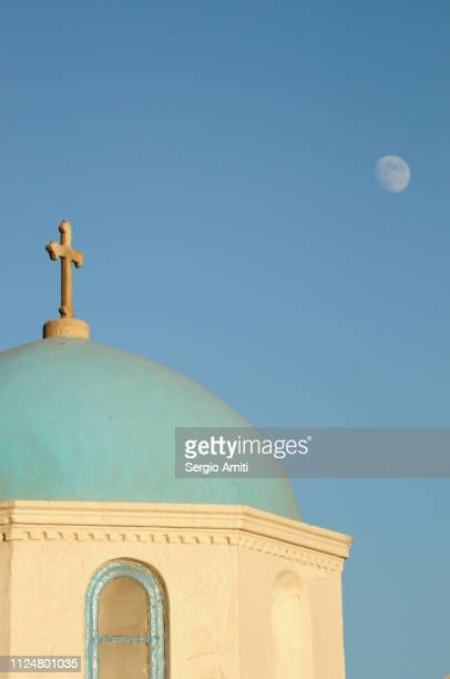the moon over a greek church bell tower - greek orthodoxy stock pictures, royalty-free photos & images