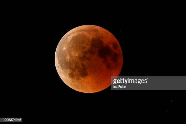The moon over Regensburg during the total lunar eclipse on July 27 2018 in Regensburg Germany