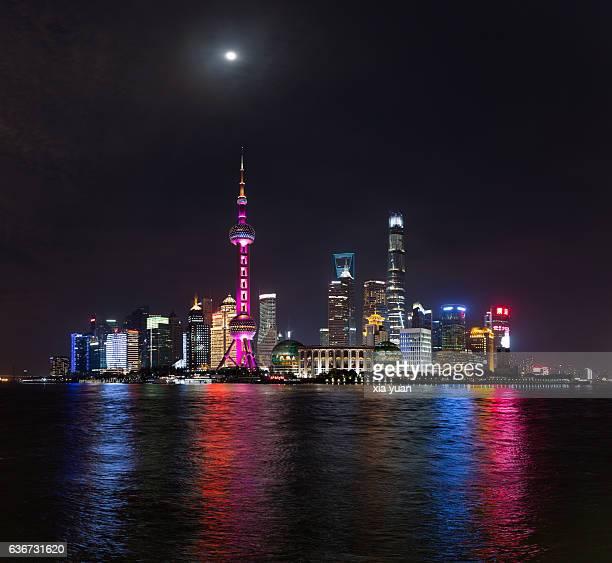 The Moon Over Shanghai Skyline.