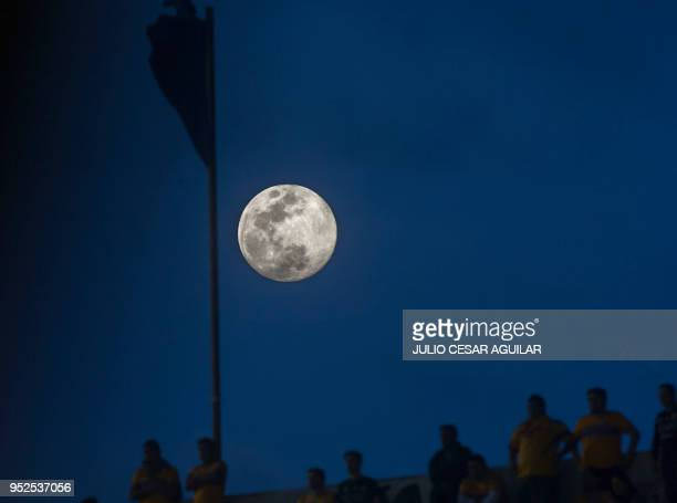 The moon raises over the Universitario stadium in Monterrey Mexico during the Mexican Clausura 2018 tournament football match between Tigres and...