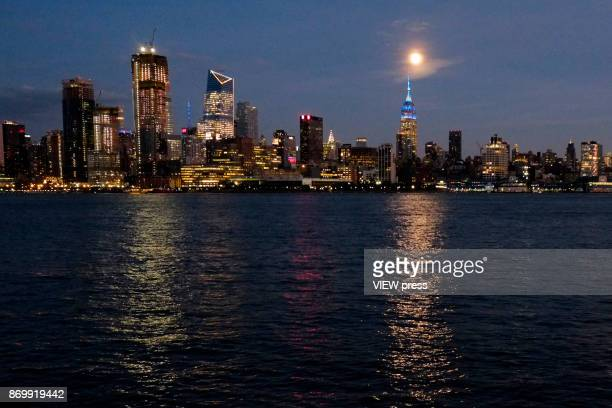 The moon rise over the Empire State Building on November 2 2017 as it is seen from Hoboken NJ