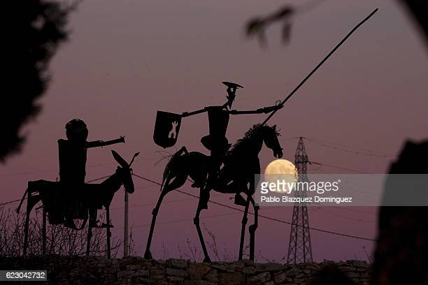 The moon rises behind a sculpture of Don Quixote De La Mancha a day before the supermoon on November 13 2016 in Munera near Albacete Spain On...