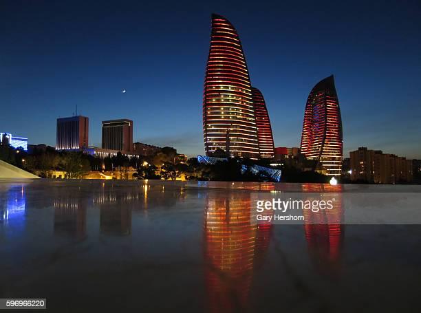 The moon rises behind the Flame Towers at sunset in Baku, Azerbaijan, May 1. 2014.