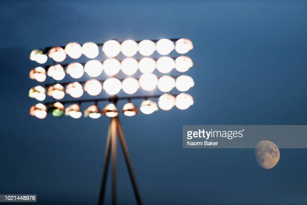 The moon rises behind the stadium floodlight during the Sky Bet League One match between Gillingham and Sunderland at Priestfield Stadium on August...