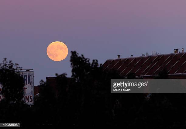 The moon rises during day three of the Boston Calling Music Festival at Boston City Hall Plaza on September 27 2015 in Boston Massachusetts
