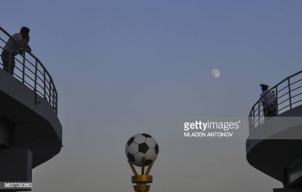 TOPSHOT The moon rises in the sky ahead of the Russia 2018 World Cup Group B football match between Iran and Portugal at the Mordovia Arena in...