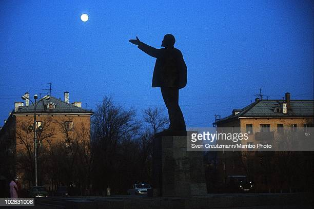 The moon rises over a giant statue of Vladimir Ilych Lenin former Bolshevik leader of the 1917 October Revolution and the first Head of state of the...