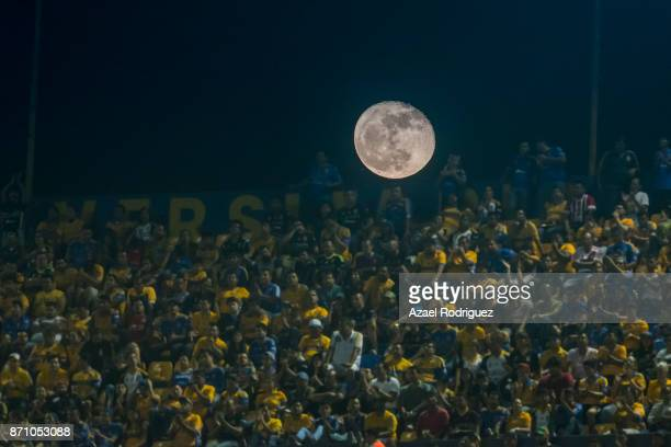 The moon rises over fans of Tigres during the 16th round match between Tigres UANL and Necaxa as part of the Torneo Apertura 2017 Liga MX at...