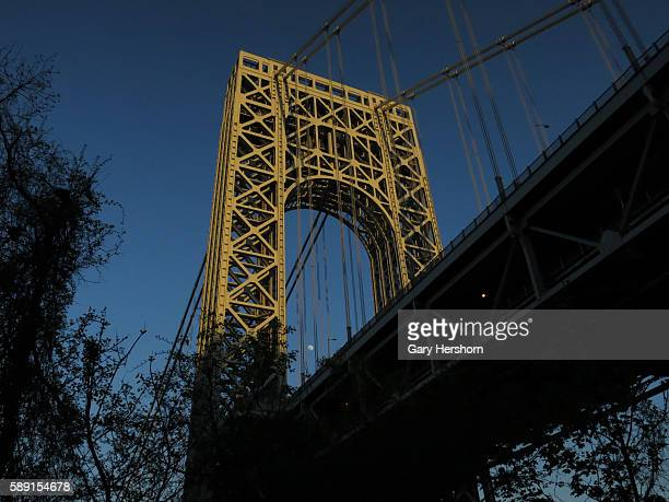 The moon rises over New York's George Washington Bridge as seen from Fort Lee New Jersey May 11 2014