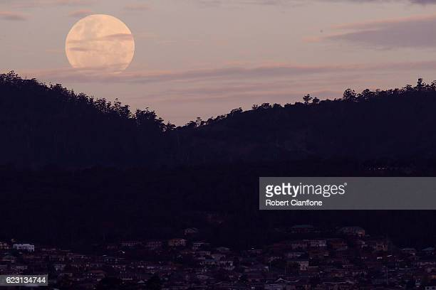 The moon rises over the city of Hobart on November 14 2016 in Hobart Australia A super moon occurs when a full moon passes closer to earth than usual...