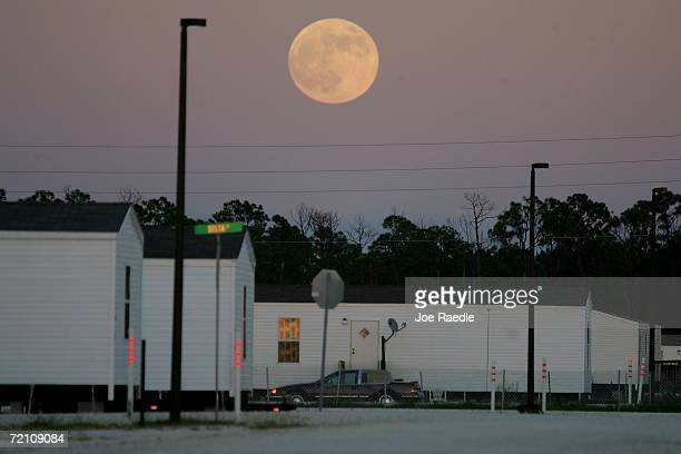 The moon rises over the Federal Emergency Management Agency trailers in FEMA City October 6 2006 in Punta Gorda Florida People displaced during the...