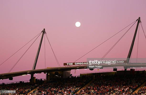 The Moon rises over the Gregan Larkham stand during the round nine Super Rugby match between the Brumbies and the Force at Canberra Stadium on April...