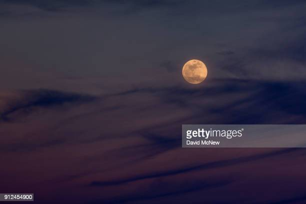 The Moon rises over the Mojave Desert before becoming a socalled 'super blue blood moon' when it becomes totally eclipsed before dawn on January 31...