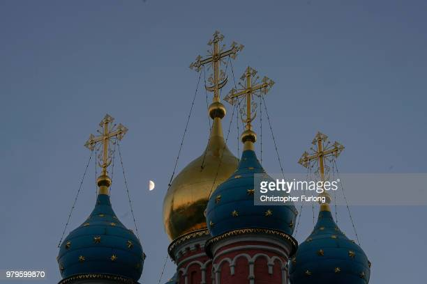 The moon rises over the Temple of St George the Victorious near Red Square on June 20 2018 in Moscow Russia Uruguay's 10 win over Saudi Arabia has...
