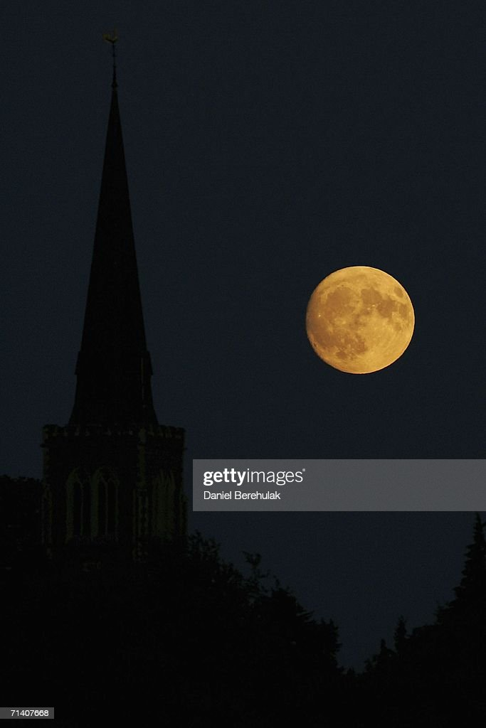 The moon rises over Wimbledon on day thirteen, the last day of the Wimbledon Lawn Tennis Championships, at the All England Lawn Tennis and Croquet Club on July 9, 2006 in London, England.