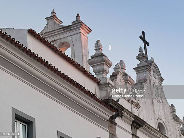 The moon rising at sunset in Evora