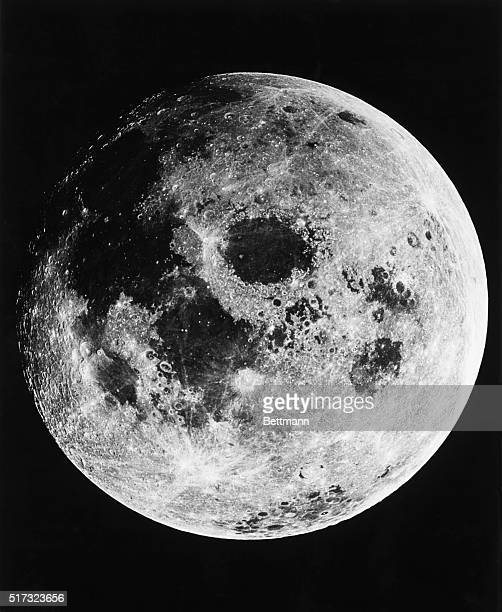 The moon seen from 10000 miles out in space from the Apollo 11 mission spacecraft as it returned to Earth Neil Armstrong and Buzz Aldrin two of the...