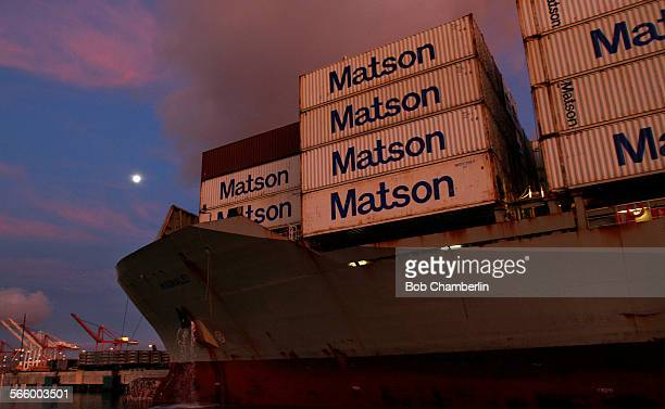 The moon sets on Matson Line container ship the Port of Long Beach at dawn on APRIL 14 2011