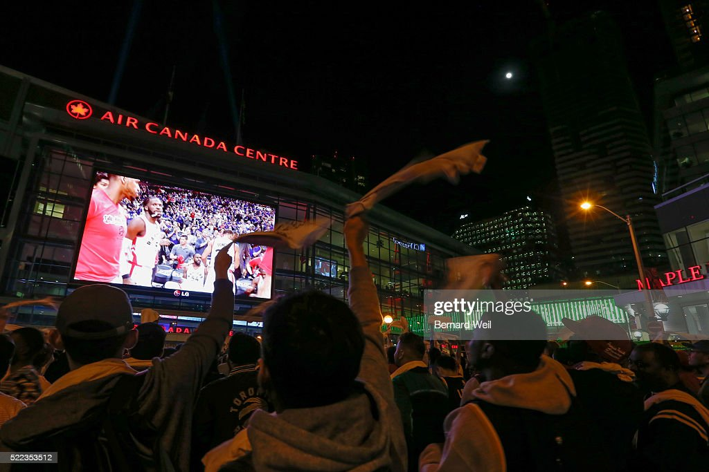 TORONTO, ON - APRIL 18 - The moon sets over Ford Fan Zone at Maple Leaf Square, during second half action in game 2 between Toronto Raptors and Indiana Pacers. April 18, 2016.