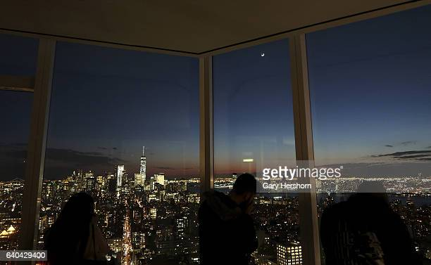 The moon sets over lower Manhattan as seen from the 56th floor of the Madison Square Park Tower on January 30, 2017 in New York City.