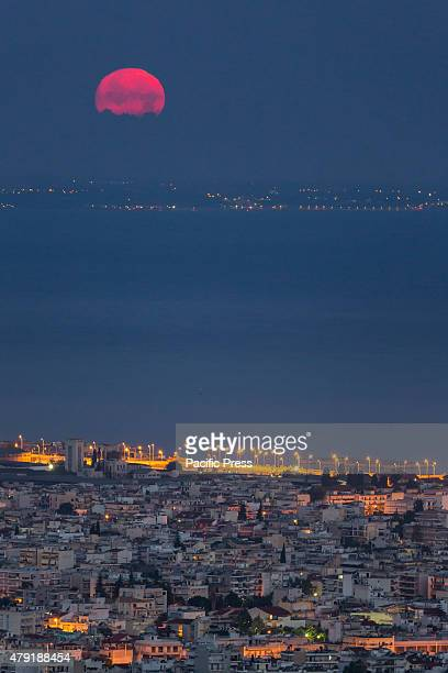 The moon sets over the Harbour of Patras Greece's third largest urban area on Wednesday July 1st 2015 Greece's lastminute overtures to international...
