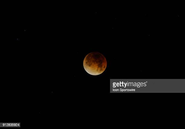 The moon sits in the night sky in the early morning hours during the Super Blue Blood Moon Lunar Eclipse on January 31 2018 in Union City CA