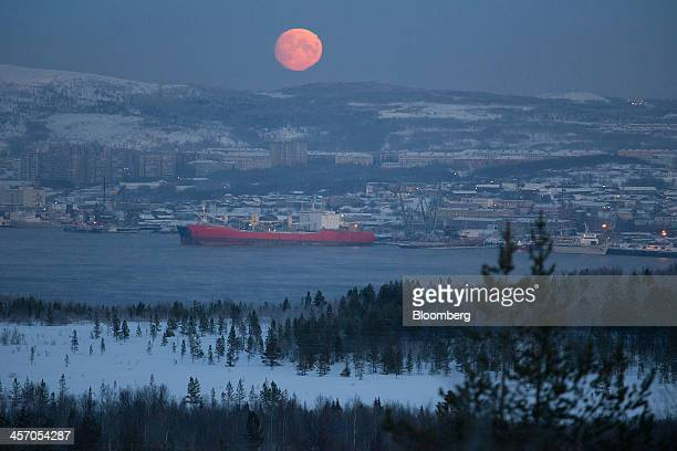 The moon sits on the horizon above the Port of Murmansk in Murmansk Russia on Sunday Dec 15 2013 The threeweek long Ukrainian protests are...