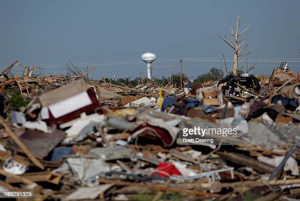 The Moore water tower stands in the distance May 22 2013 in Moore Oklahoma The twomilewide Category 5 tornado touched down May 20 killing at least 24...