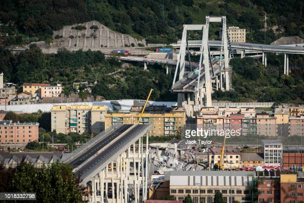 The Morandi Bridge still partially stands after a large section of it collapsed earlier this week on August 17 2018 in Genoa Italy At least 38 people...