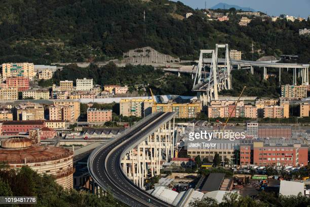 The Morandi Bridge still partially stands after a large section of it collapsed earlier this week on August 19 2018 in Genoa Italy 43 people were...