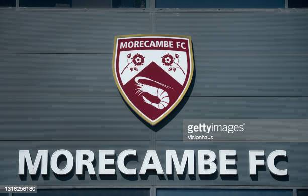 The Morecambe FC club badge on the front of the Mazuma Stadium main entrance before the Sky Bet League Two match between Morecambe and Bolton...