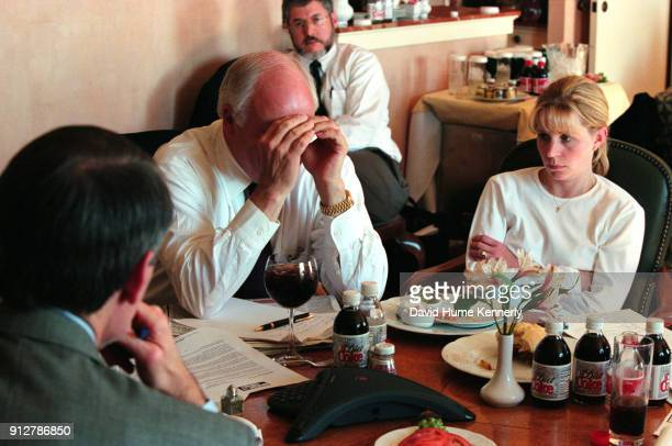 The morning after the election without a clear winner vice presidential candidate Dick Cheney talks with daughter Liz Cheney and advisers at the Four...