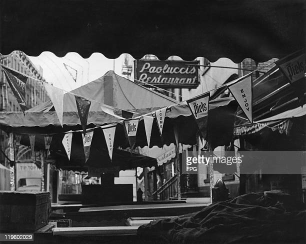The morning of the San Gennaro festival on Mulberry Street on the Lower East Side of New York City September 1966