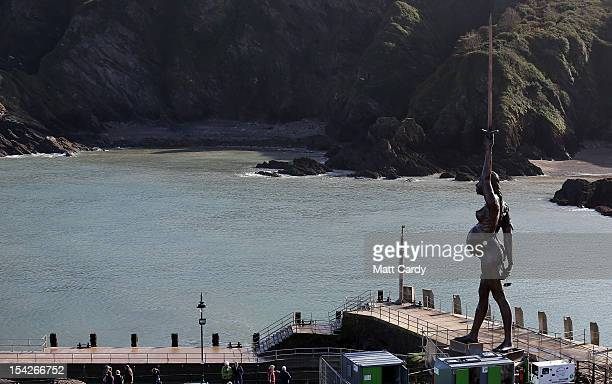 The morning sun illuminates Damien Hirst's bronze sculpture of a pregnant woman on October 17 2012 in Ilfracombe England The bronzeclad swordwielding...