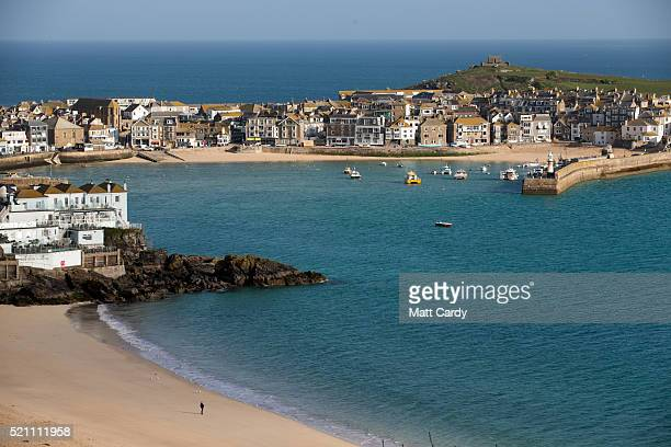 The morning sun illuminates properties in the popular seaside resort of St Ives on April 14, 2016 in Cornwall, England. Due to the pressures that...