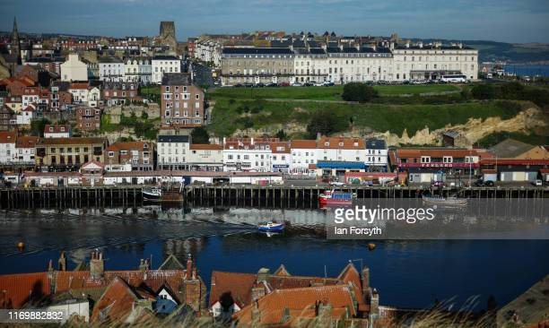 The morning sun shines down on Whitby Harbour on August 24 2019 in Whitby England Temperatures are expected to climb over 30C in parts of the country...