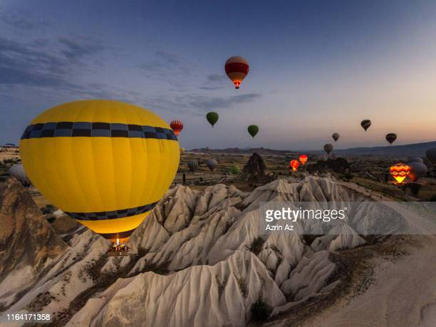 the morning sunrise ballooning in the sky - azrin az stock pictures, royalty-free photos & images