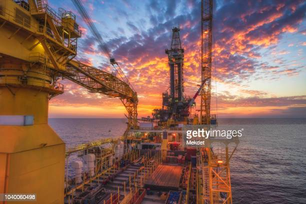 the morning view of oil drilling rig (tender assisted rig type) in gulf of thailand - oil rig stock pictures, royalty-free photos & images