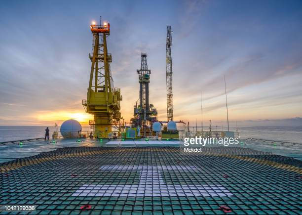the morning view of oil drilling rig (tender assisted rig type) in gulf of thailand - transportation building type of building stock photos and pictures
