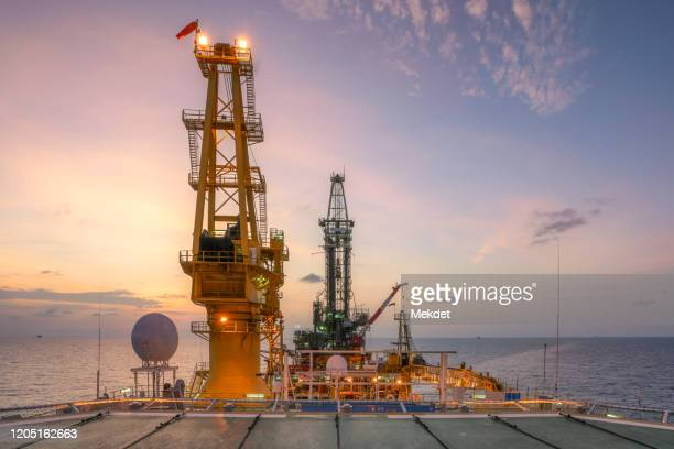 the morning view of oil drilling rig (tender assisted rig type) in gulf of thailand - transportation building type of building stock pictures, royalty-free photos & images