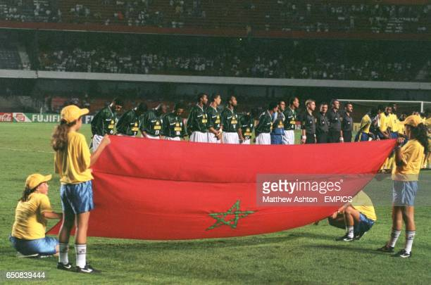The Moroccan flag is held up as the Raja Casablanca players stand for their national anthem