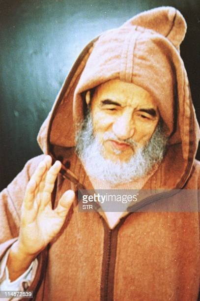 The Moroccan Mulism leader Abdessalam Yassine gestures on this photo taken by a person close to him 10 January 1990 at Sala in the Rabat area...