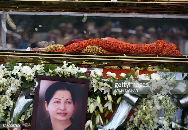 The mortal remains of Indian politician and actress Jayalalithaa Jayaram are carried during a procession to her burial place in Chennai on December 6...